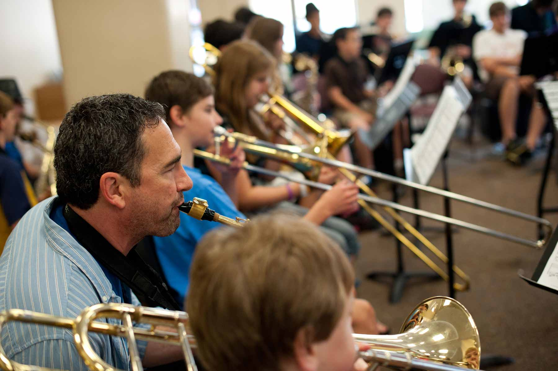 kids and teachers playing musical instruments