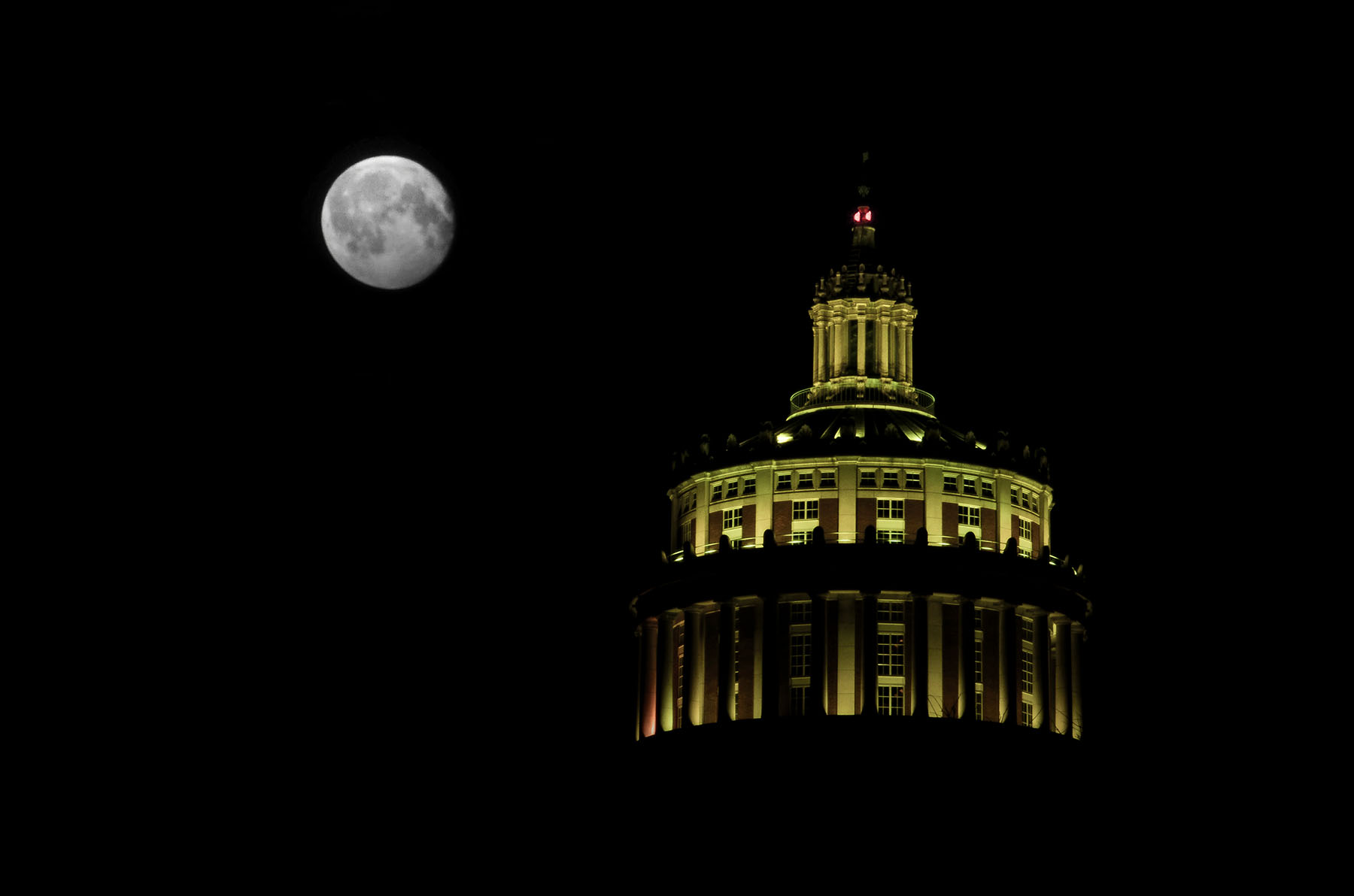 Rush Rhees Library tower under the full moon
