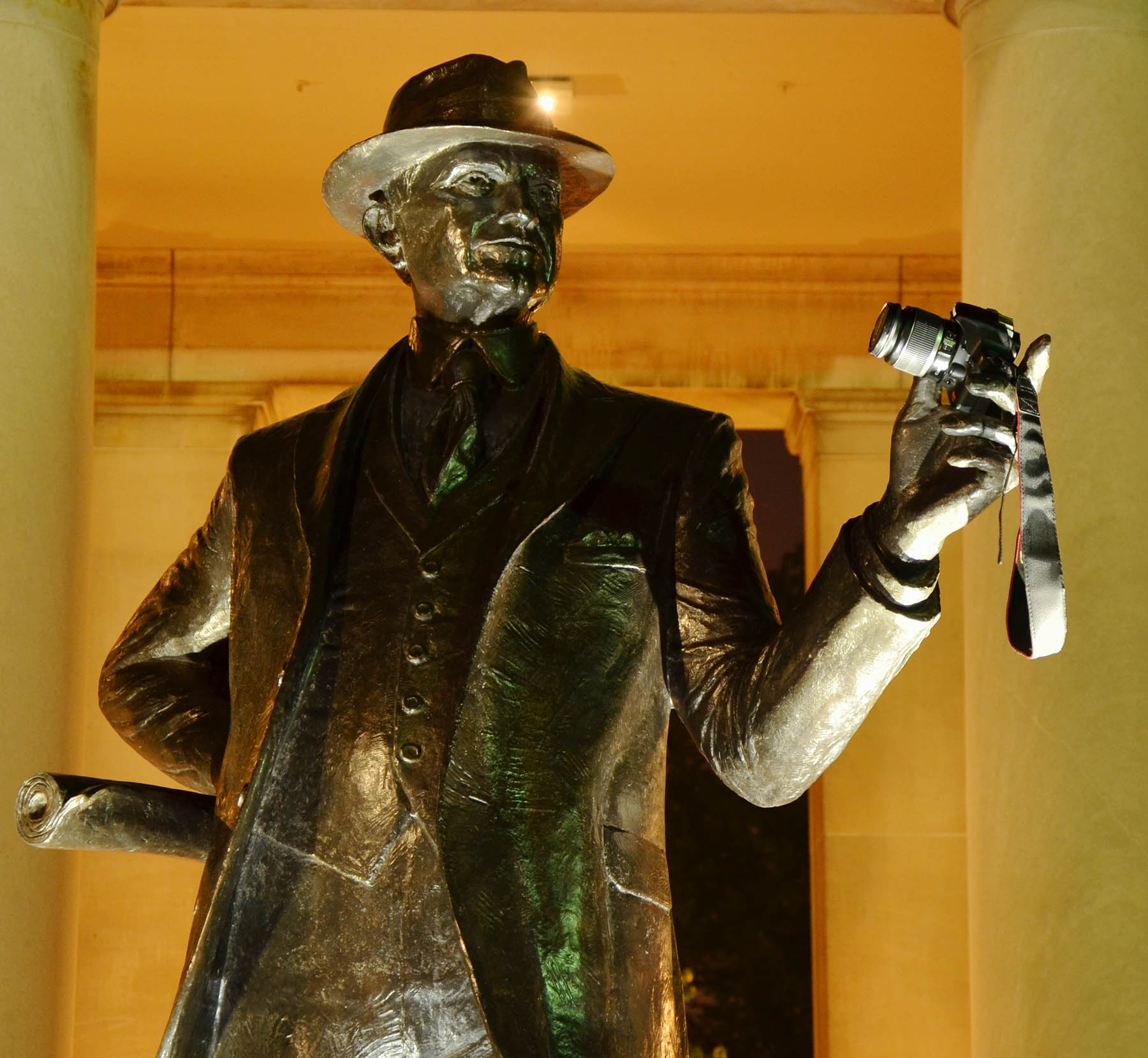 George Eastman statue holding a camera