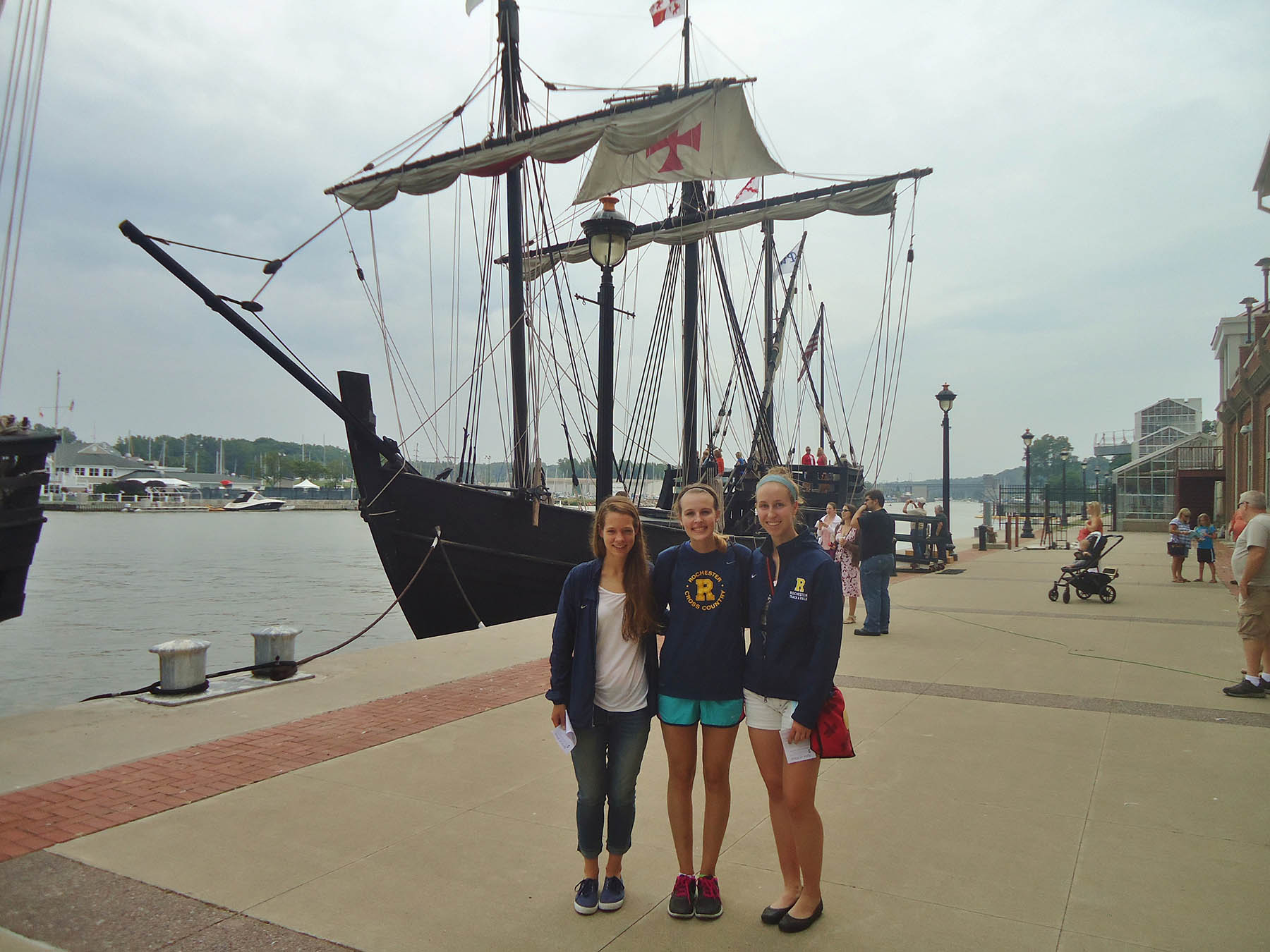 students stand by replica ship