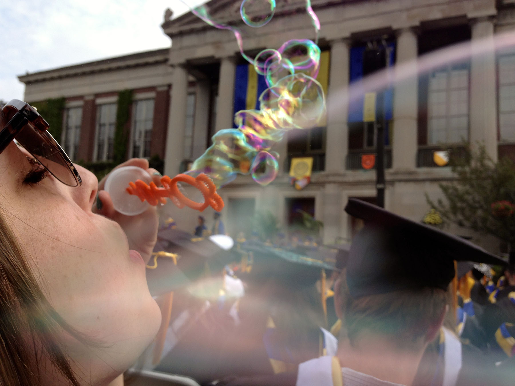 graduate blowing bubbles