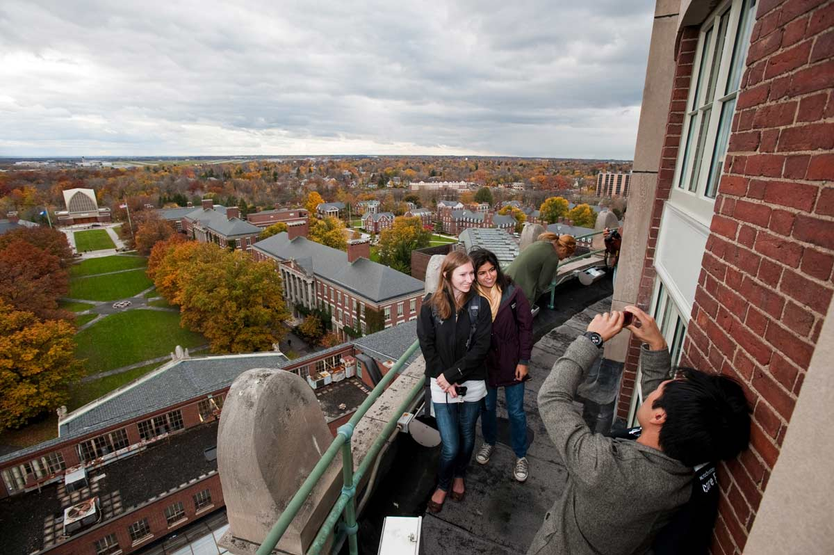 taking photos on top of Rush Rhees tower