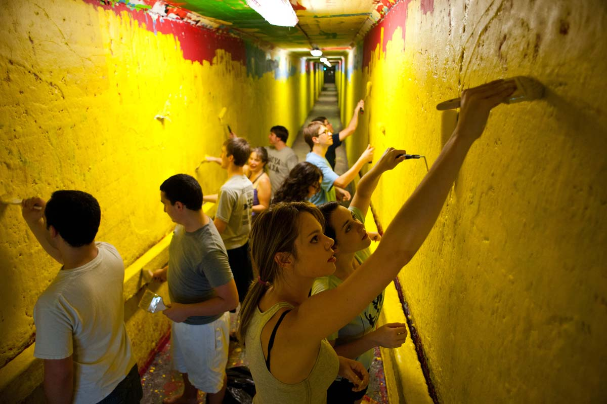 students painting the tunnels