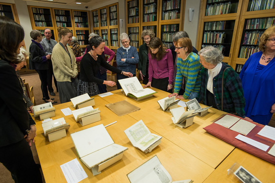 people looking at books on display on a table