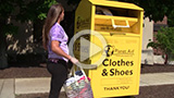 girl throwing clothes into yellow bin
