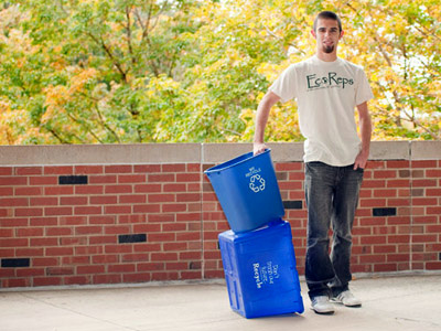 young man with recycle bins