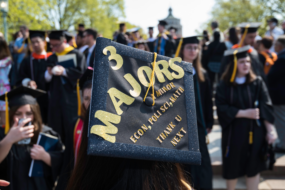 Graduation cap with multi-disciplinary study focus at University of Rochester