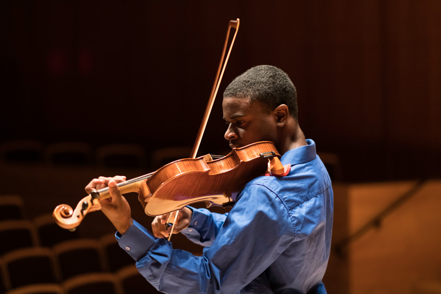 Violinist performing solo at the University of Rochester Eastman School of Mucis