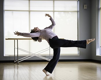 Student dances in a studio