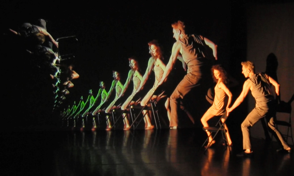 Composite image shows multiple images of a man and woman dancing with a chair.
