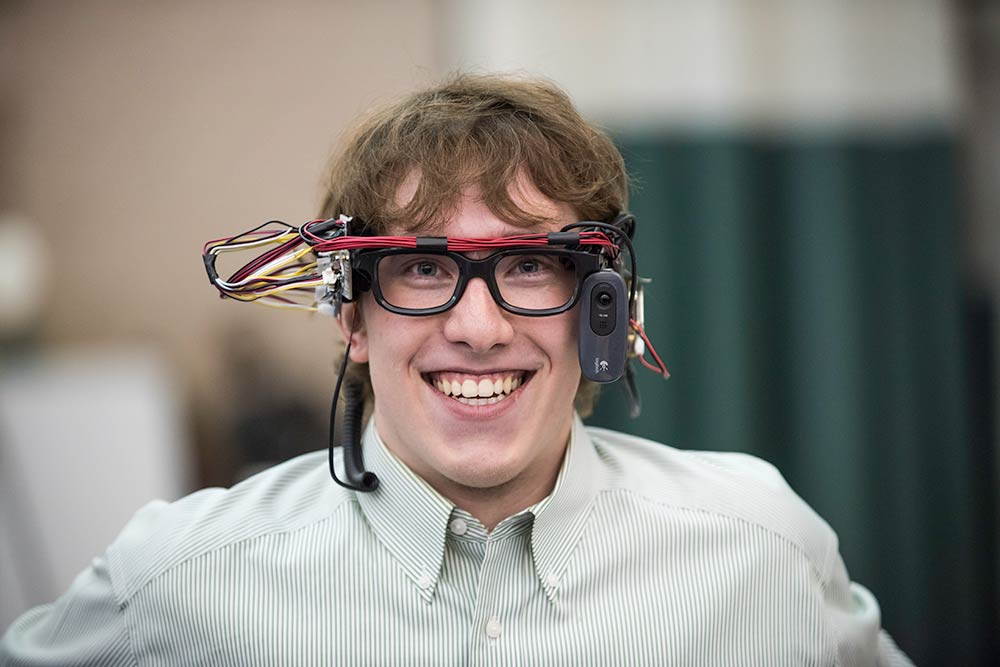 Student smiles while wearing VR goggles