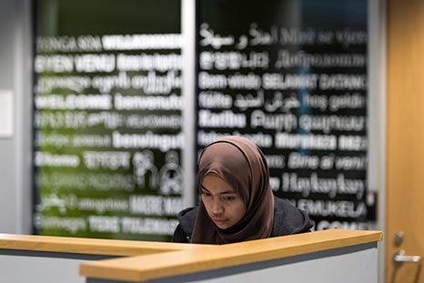 A student studying in the language center.